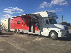 Renegade toter with bunk beds and garage.  22' stacker trailer