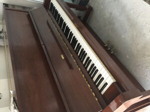 Full sized upright Yamaha piano