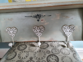 Shabby chic shelf with heart hooks