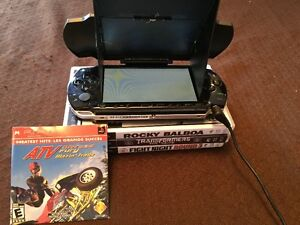 Sony PSP with games, glare shield and power cord