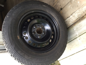 4 Winter tires on rims - only used one full winter season.