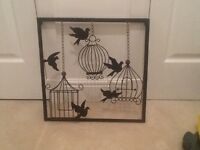Next bird and cages metal wall art