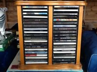 Collection of about 35 cds with cd storage unit in pine
