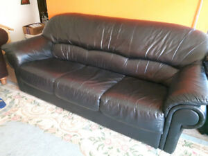 Black leather sofa in good condition free pets and smoke.