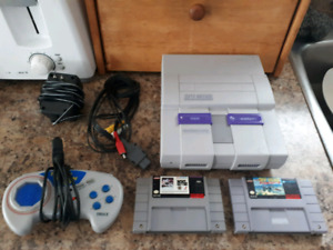 Super Nintendo System With A Controller And 2 Games!