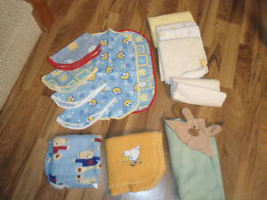assorted flannel blankets and other