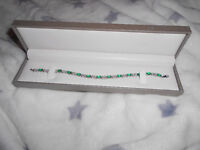 Brand new green gems and silver hearts bracelet