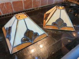 Two tiffany style lamp shades.