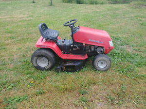 Red riding lawnmower