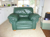 Green Leather plush armchair.