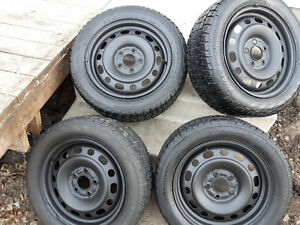 Studded Avalanche X-treme winter tires on rims,  205/55/R16