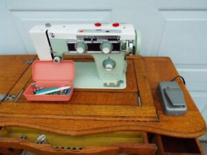 Electric sewing Machine in antique cabinet - $75
