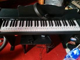 Electronic piano with stool, pedal and headphones