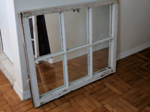 Antique white mirrored window pane