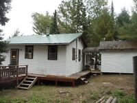 WATERFRONT COTTAGE ON BIG LOT !