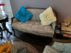 2 chairs and a love seat