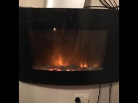Wall mounted electric fire curved