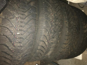 "Snow tires on rims 15"" — used for two seasons"