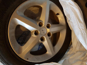 Great condition All season tires on OEM aluminum Rims 215/55/R17