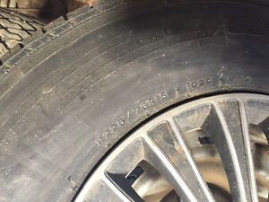 Tires and rims from a Chevy Vandura London Ontario image 1