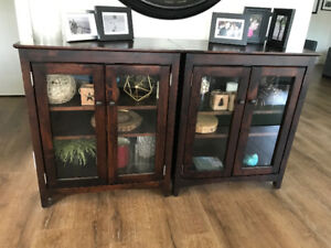 Two solid wood cabinets with glass fronts