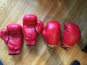 Two sets of everlast boxing gloves