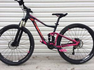 Two giant mountain bikes (Trance) (Liv)
