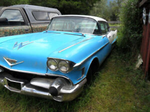 two black & blue 1958 caddys 4dr hard top