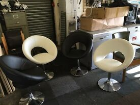 Black and cream swivel dining chairs