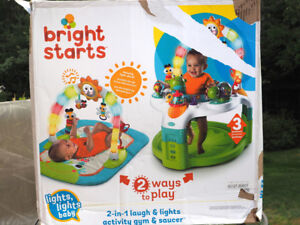 Bright start 2 in 1 laugh and lights activity gym and saucer