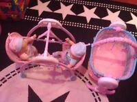 Fisherprice swinging crib and swing, with dolls.