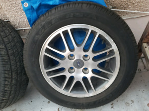 4 all season tires and rims off 2011 ford focus