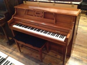Baldwin upright piano and bench