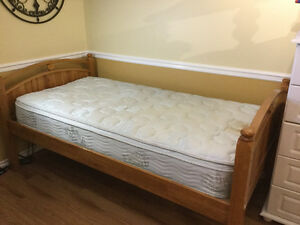 Twin bed for sale. Solid wood with platform base