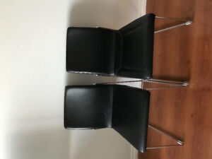 Chairs from Moebler, black leather in very good condition.