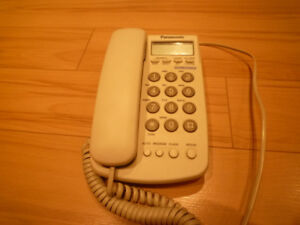 Home phone $5.00 plugs into the wall