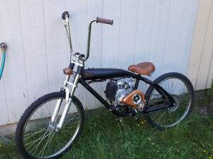 Motorized bicycle, aluminum gas tank frame 4 stroke.