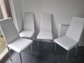 White leather look dining room chairs