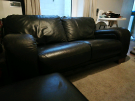 DFS two seater leather brown sofa & matching footstool