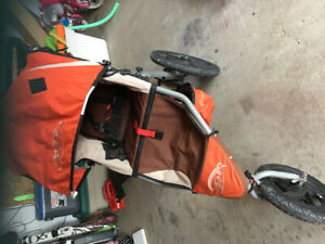 Stroller with cover and car seat adapter