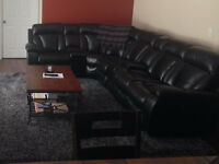 Black Leather Sectional - Trade
