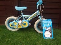 Girls first Apollo bike with stabilisers