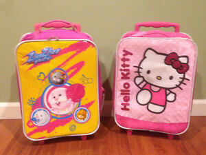 Two child's rolling suitcases ($10 each) will sell separate