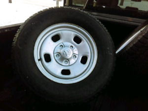 Four Season Cooper Discoverer A/TW on 17 in. steel Ram rims