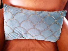 Teal blue scallop-studded cushion