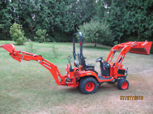 Kubota BX25D Tractor 4X4 Diesel with bucket, back hoe, 3pt hitch