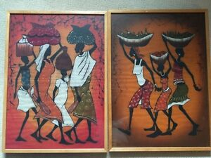 2 large African cloth prints in wooden frames