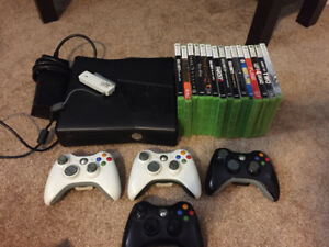 X Box 360, 4 controllers, wifi booster and 15 assorted games