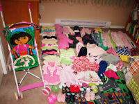 Lot (70 + items) of girl's clothing, shoes + a stroller