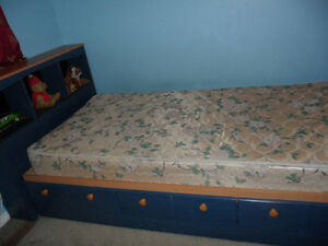 single size storage bed with night table